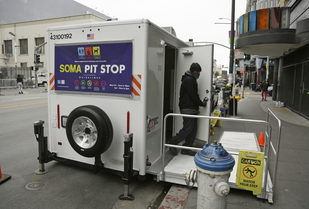 "An attendant exits a ""Pit Stop"" public toilet on Sixth Street, Thursday, Aug. 1, 2019, in San Francisco. A 5-year-old portable toilet program in San F..."