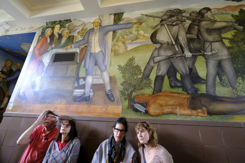 "People stand in the main entryway of George Washington High School to view the controversial 13-panel, 1,600-square foot mural, the ""Life of Washingto..."