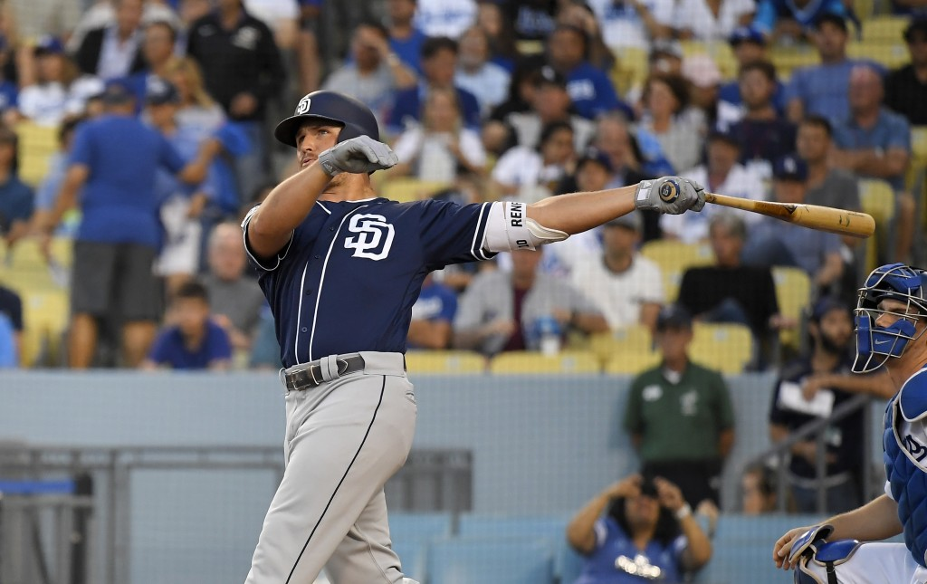 San Diego Padres' Hunter Renfroe watches his solo home run next to Los Angeles Dodgers catcher Will Smith during the second inning of a baseball game ...