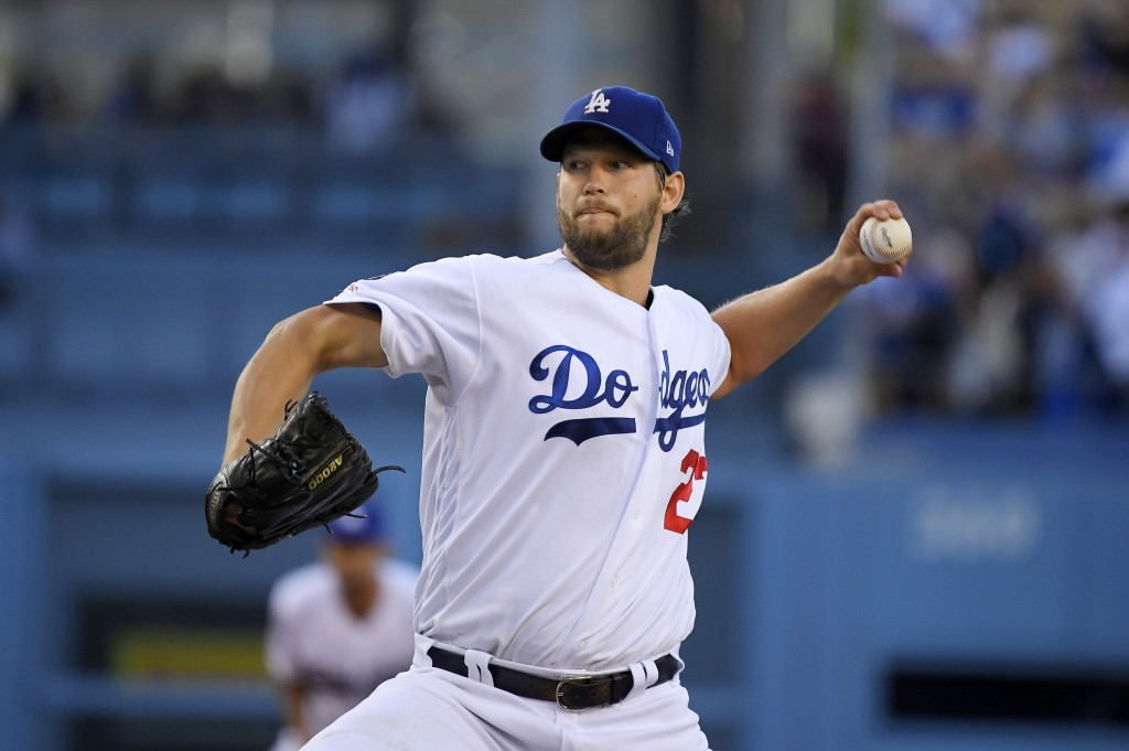 Los Angeles Dodgers starting pitcher Clayton Kershaw throws during the first inning of the team's baseball game against the San Diego Padres on Thursd...