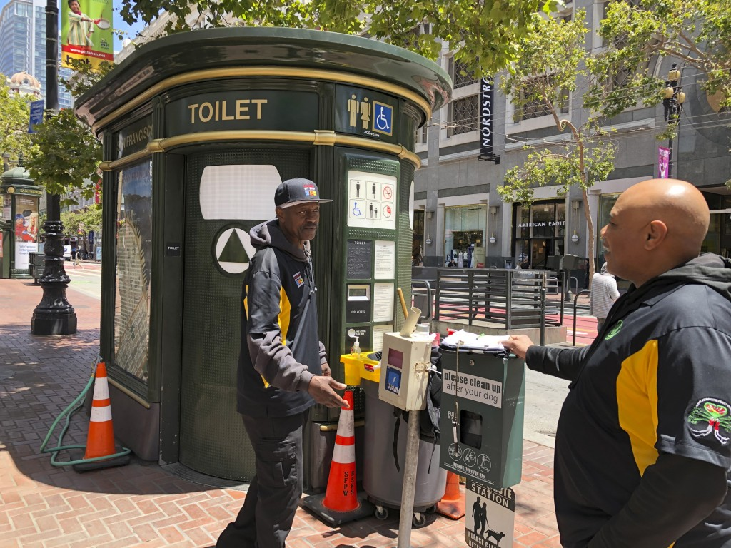 "In this photo taken July 18, 2019, Nelson Butler, right, greets Lester ""Smokey"" Williams at one of the 25 ""Pit Stop"" locations in San Francisco. The p..."