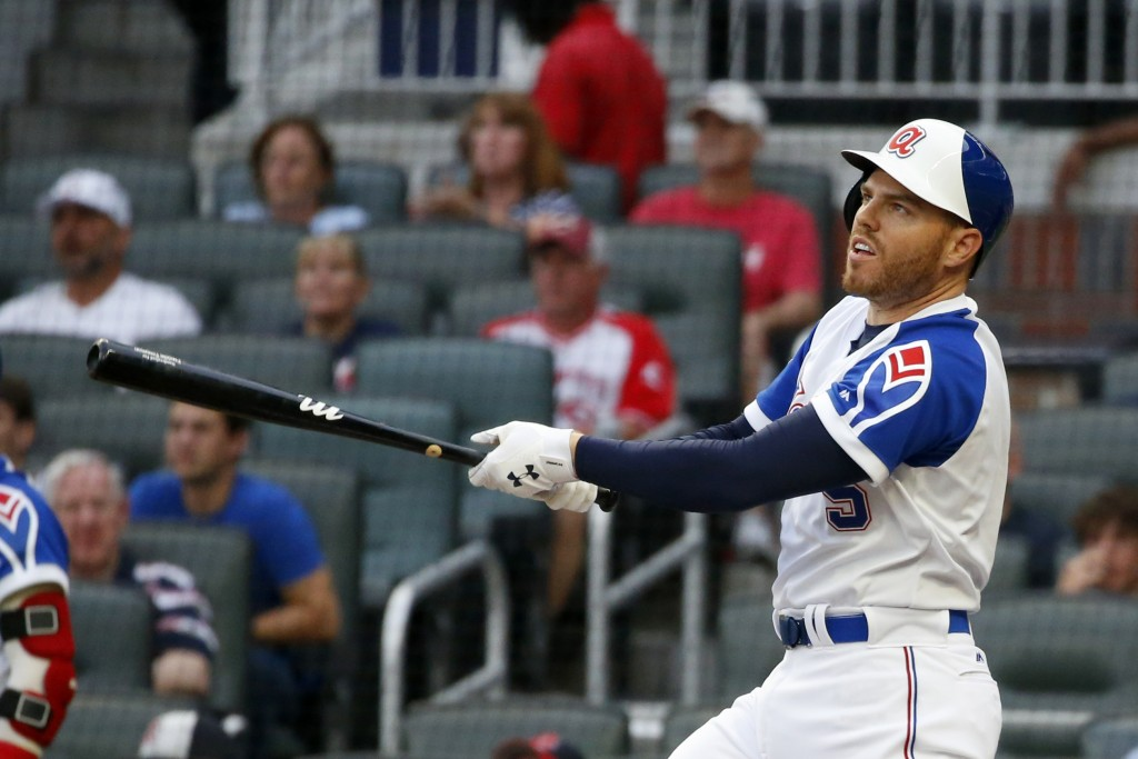 Atlanta Braves' Freddie Freeman watches his three-run home run during the first inning of the team's baseball game against the Cincinnati Reds on Thur