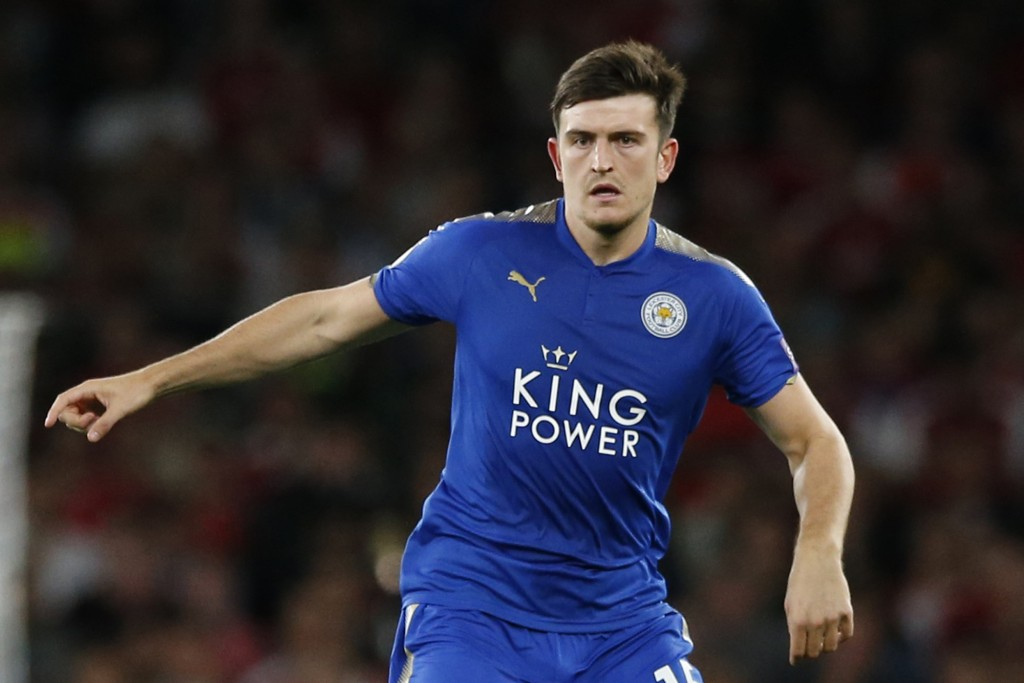 FILE  - In this Friday, Aug. 11, 2017 file photo, Leicester City's Harry Maguire looks to pass the ball during their English Premier League soccer mat