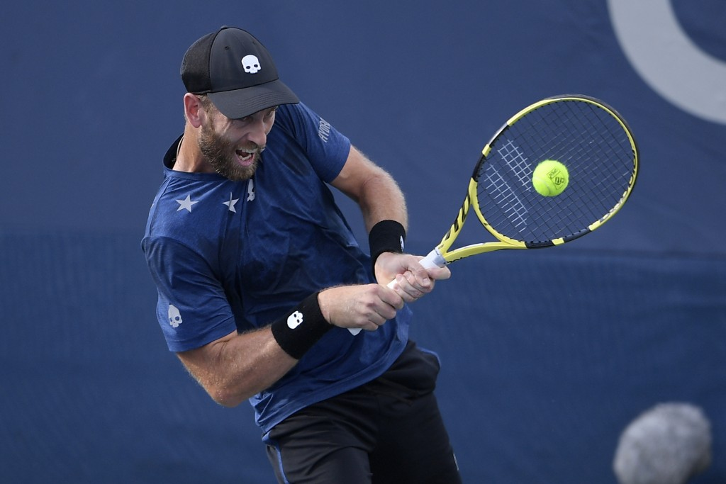 Michael Venus, of New Zealand, returns the ball as he and Raven Klaasen, of South Africa, played a doubles match against Andy Murray and Jamie Murray,