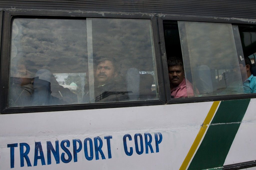 Indian pilgrims sit inside a government bus as they prepare to leave Srinagar, Indian controlled Kashmir, Saturday, Aug. 3, 2019. A government order i...