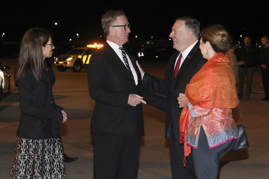 U.S. Secretary of State Mike Pompeo, second from right, and his wife Susan, right, are greeted by U.S. Ambassador to Australia Arthur Culvahouse and U...