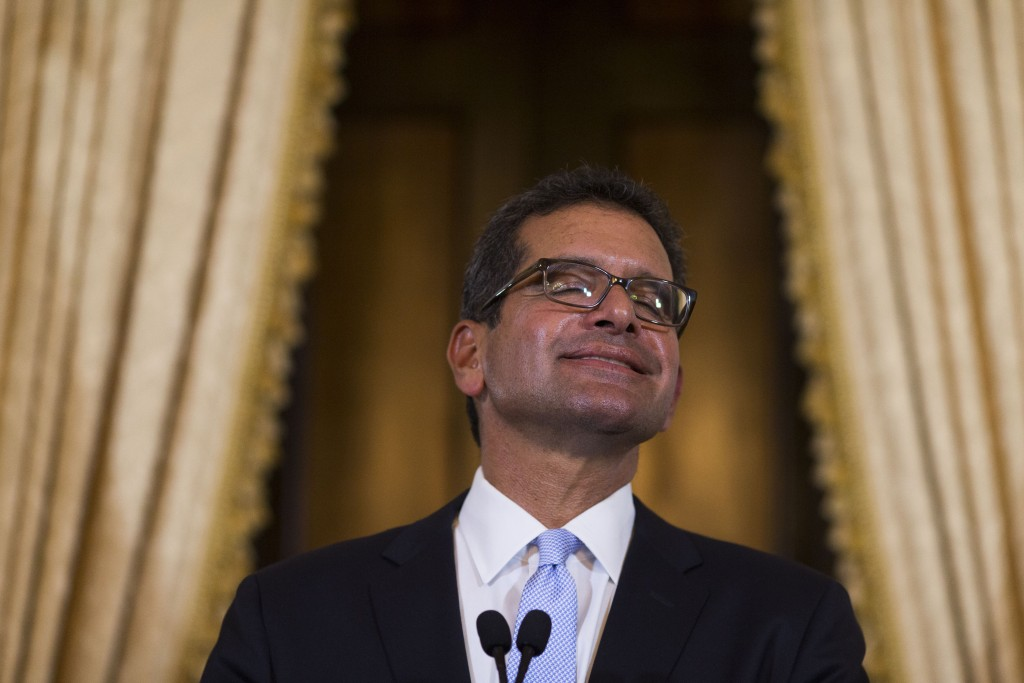 Pedro Pierluisi, sworn in as Puerto Rico's governor, smiles during a press conference in San Juan, Puerto Rico, Friday, Aug. 2, 2019. Departing Puerto