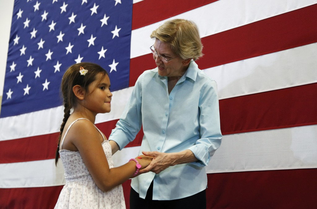 Democratic presidential candidate Sen. Elizabeth Warren, D-Mass., right, speaks with nine-year-old Melanie Weyrich during a campaign event Friday, Aug