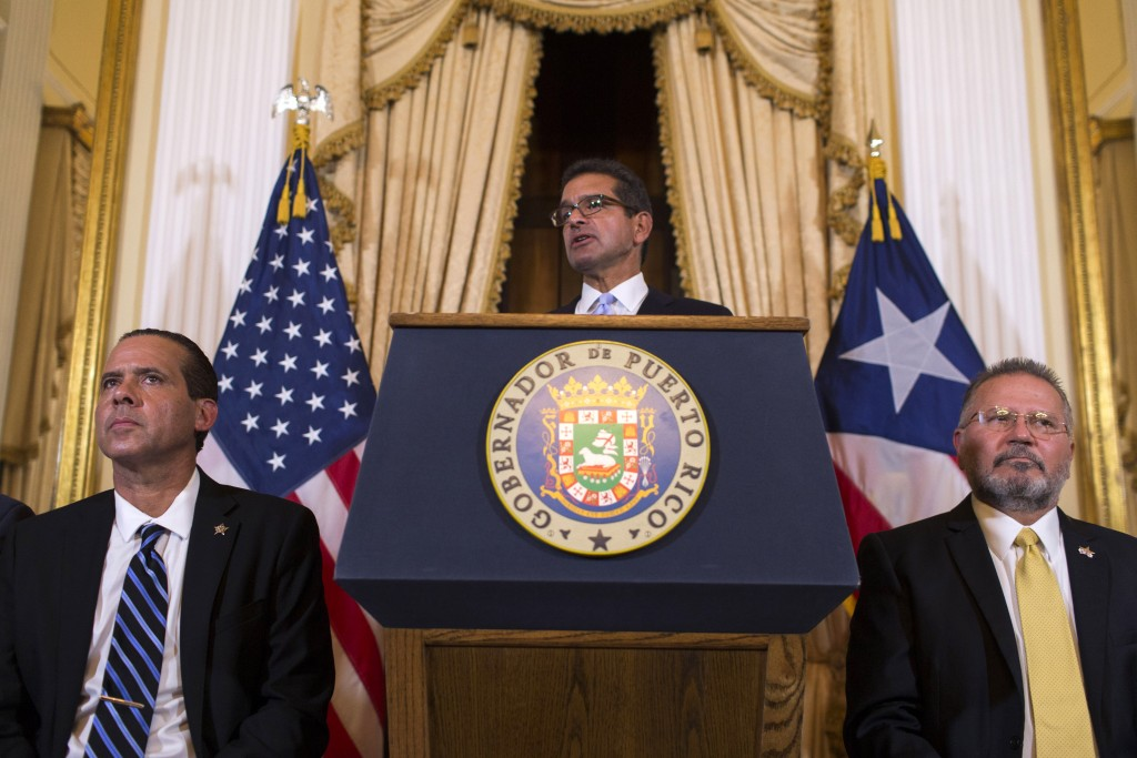 Pedro Pierluisi, sworn in as Puerto Rico's governor, speaks during a press conference, in San Juan, Puerto Rico, Friday, Aug. 2, 2019. Departing Puert