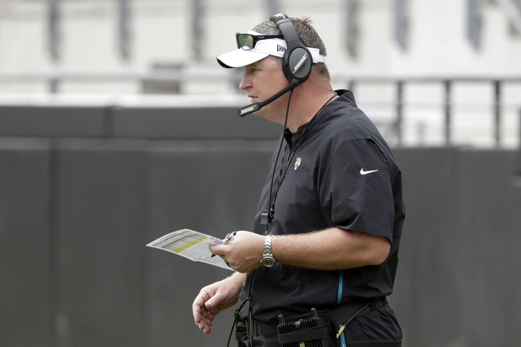 Jacksonville Jaguars head coach Doug Marrone watches his players on the field during an NFL football practice at the teams stadium, Friday, Aug. 2, 20