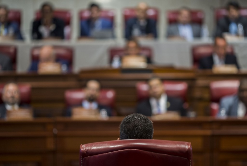 Proposed Secretary of State Pedro Pierluisi (back to camera) speaks during his confirmation hearing at the House of Representatives, in San Juan, Puer
