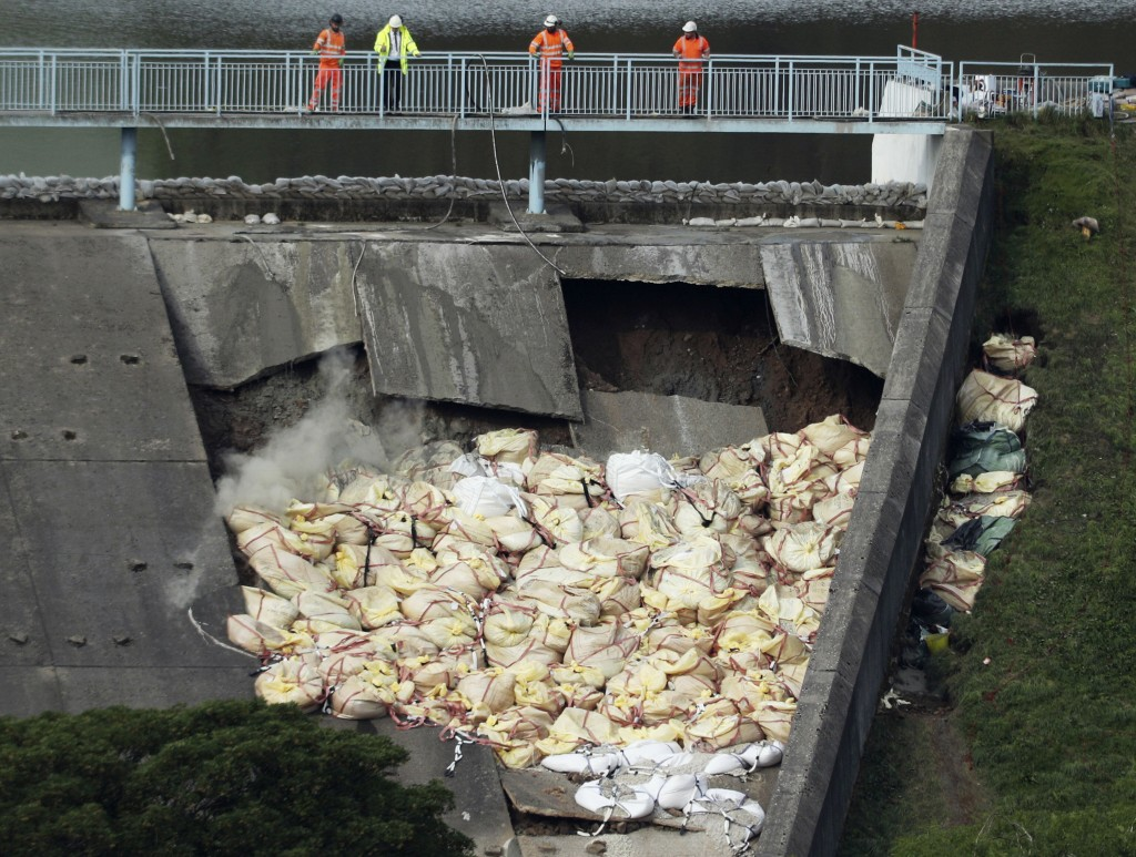 A bag of aggregate, a mixture of sand, gravel and stone, is thrown onto the damaged Toddbrook Reservoir near the village of Whaley Bridge,in Derbyshir