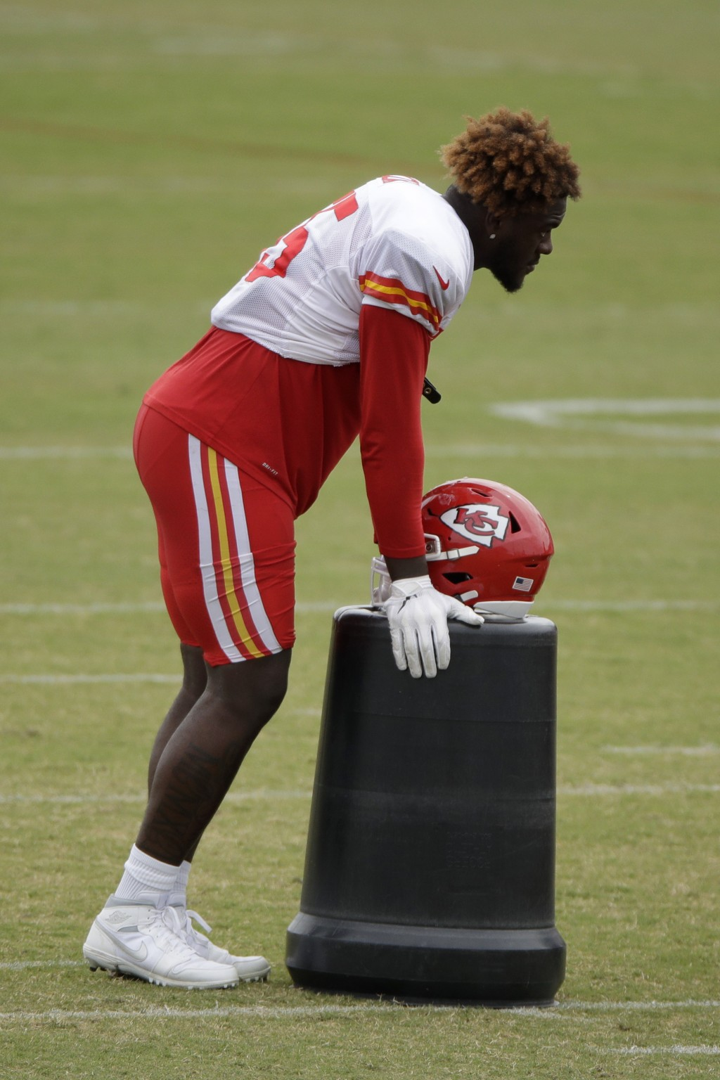 Kansas City Chiefs defensive end Frank Clark listens to instructions during NFL football training camp Friday, Aug. 2, 2019, in St. Joseph, Mo. (AP Ph...
