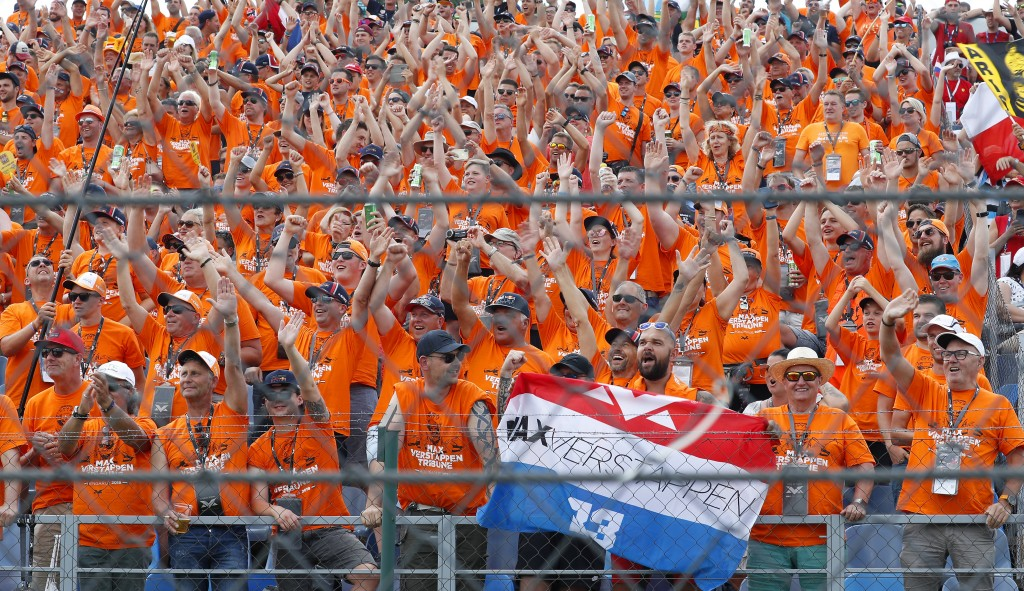 Fans of Red Bull driver Max Verstappen cheer prior to the start of the Hungarian Formula One Grand Prix at the Hungaroring racetrack in Mogyorod, nort...