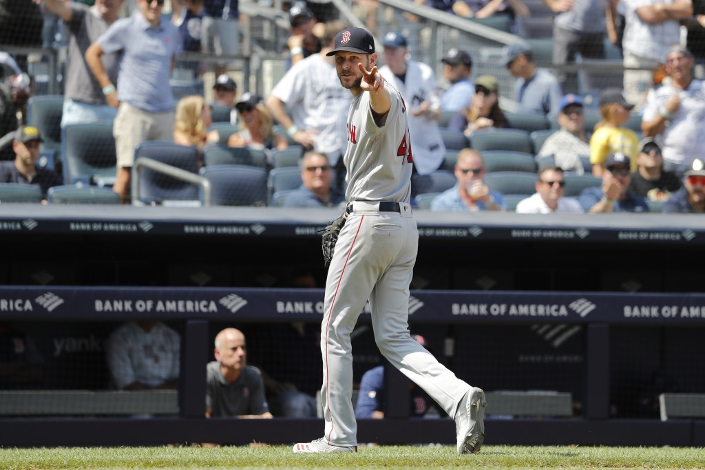 Boston Red Sox Chris Sale reacts to the umpires after being subbed out against the New York Yankees in the fourth inning of a baseball game, Saturday,