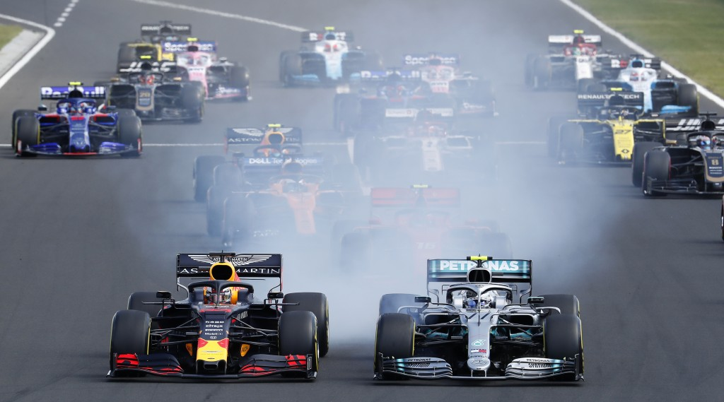 Red Bull driver Max Verstappen, left, of the Netherlands, and Mercedes driver Valtteri Bottas, of Finland, lead the field during the Hungarian Formula...