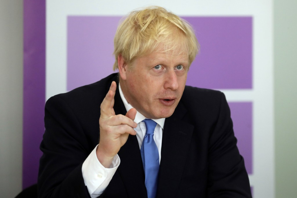 FILE - In this Wednesday, July 31, 2019 file photo, Britain's Prime Minister Boris Johnson speaks during the first meeting of the National Policing Bo...