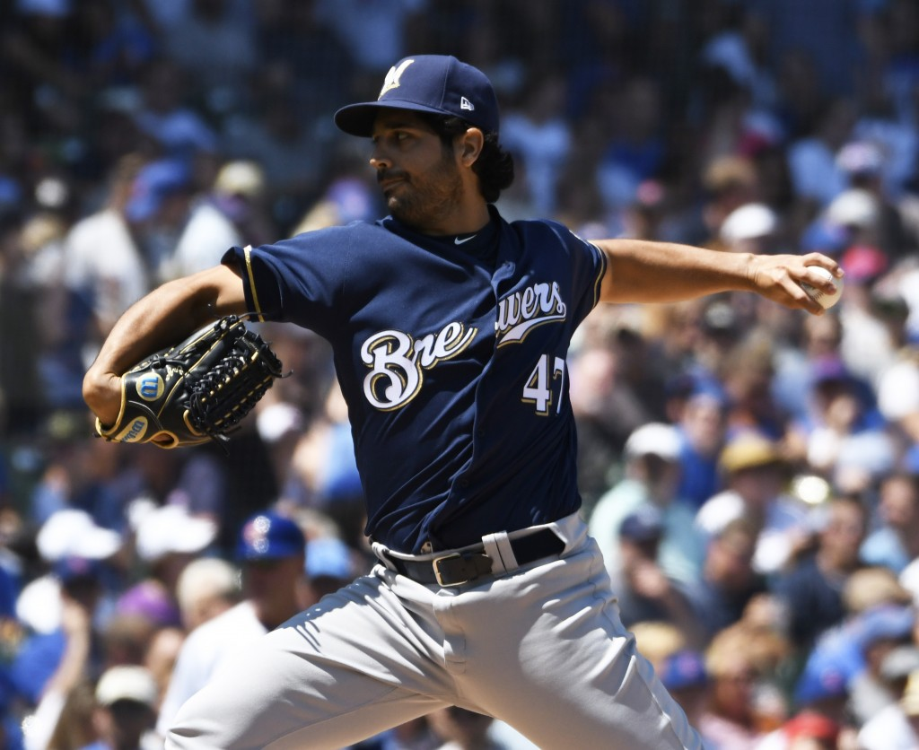 Milwaukee Brewers starting pitcher Gio Gonzalez (47) throws the ball against the Chicago Cubs during the first inning of a baseball game, Saturday, Au...