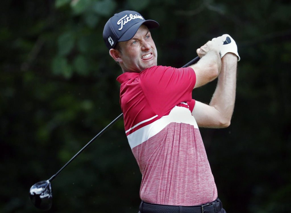 Webb Simpson hits his tee shot on the second hole during the third round of the Wyndham Championship golf tournament at Sedgefield Country Club in Gre...