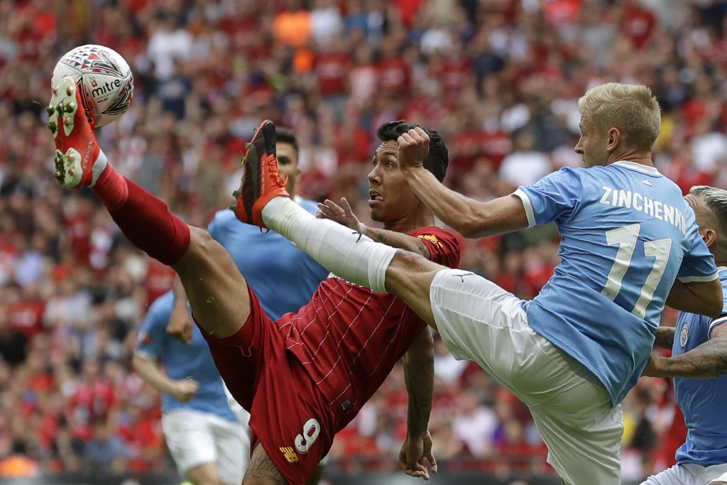 Liverpool's Roberto Firmino challenges for the ball with Manchester City's Oleksandr Zinchenko during the English Community Shield soccer match betwee...