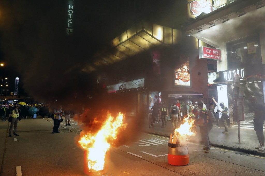 Dustbins are set on fire during a confrontation between protesters and police in Hong Kong on Saturday, Aug. 3, 2019. Protesters and authorities clash...