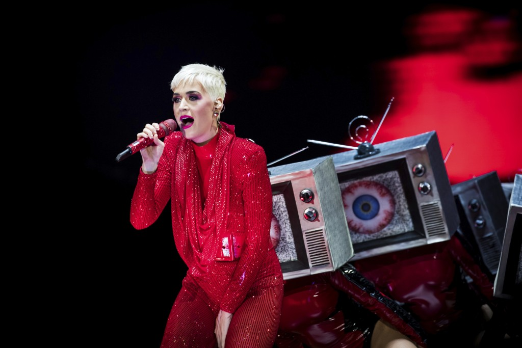 FILE - In this June 14, 2018 file photo, singer Katy Perry performs on stage at the 02 Arena in London. A Christian rapper who won a nearly $3 million