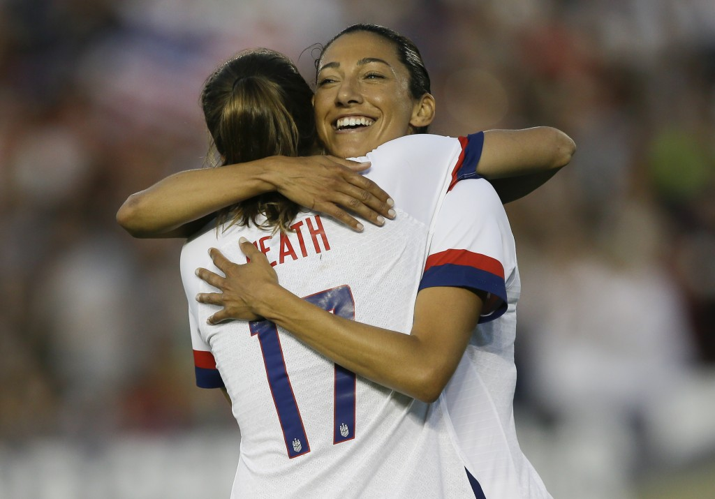 U.S.forward Christen Press hugs forward Tobin Heath, left, for Heath's goal against Ireland during the first half of an international friendly soccer