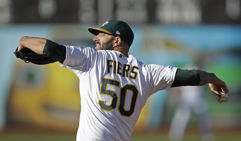 Oakland Athletics' pitcher Mike Fiers works against the St. Louis Cardinals in the first inning of a baseball game Saturday, Aug. 3, 2019, in Oakland,...