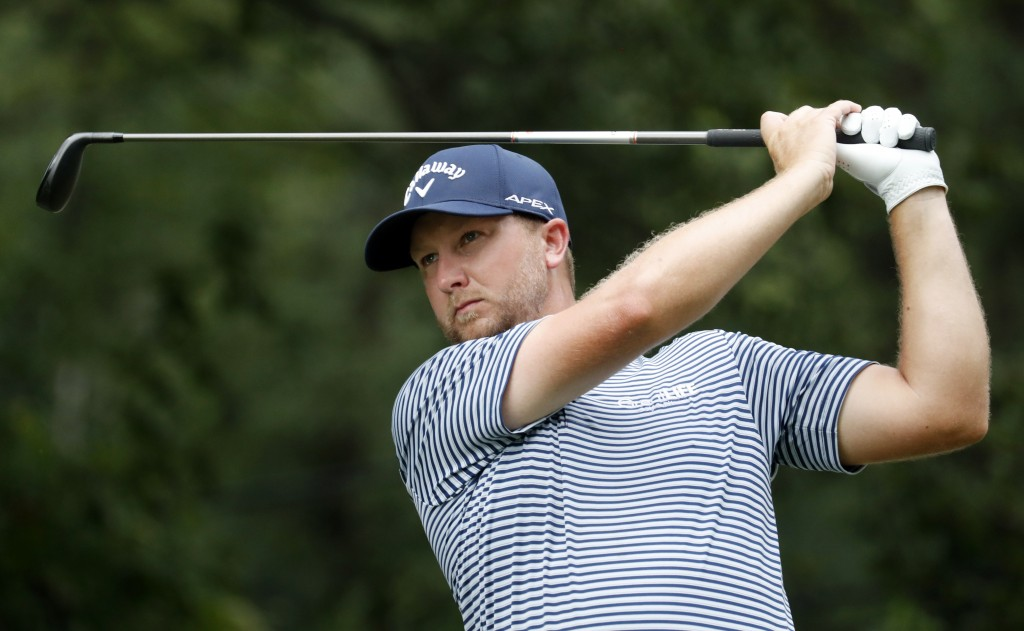Brice Garnett watches his tee shot on the fourth hole hole during the third round of the Wyndham Championship golf tournament at Sedgefield Country Cl...