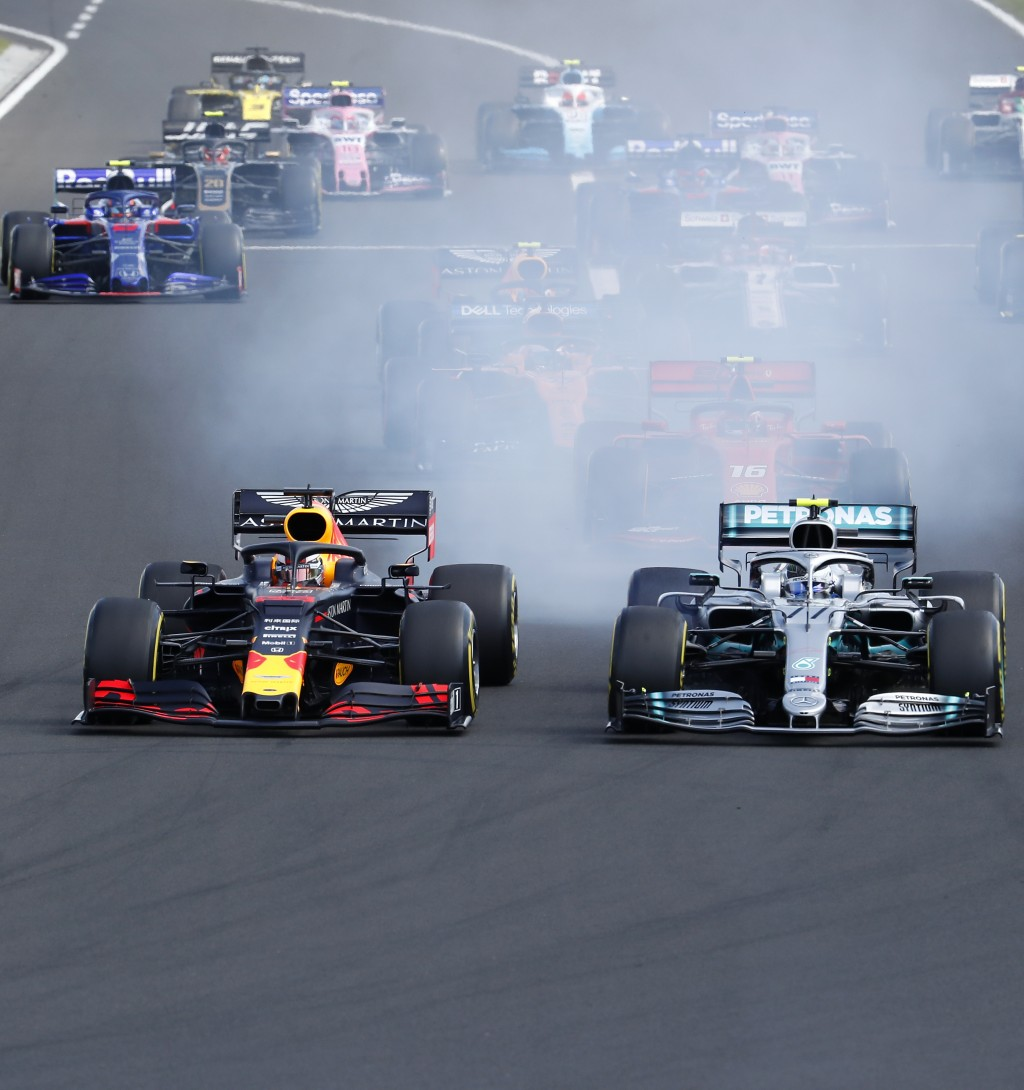 Red Bull driver Max Verstappen, left, of the Netherlands, and Mercedes driver Valtteri Bottas, of Finland, challenge for the first position after star...