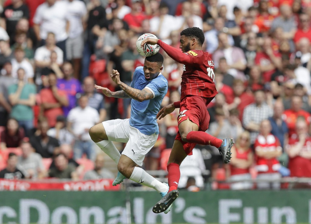 Manchester City's Gabriel Jesus, left, jumps for a header with Liverpool's Joe Gomez during the English Community Shield soccer match between Liverpoo