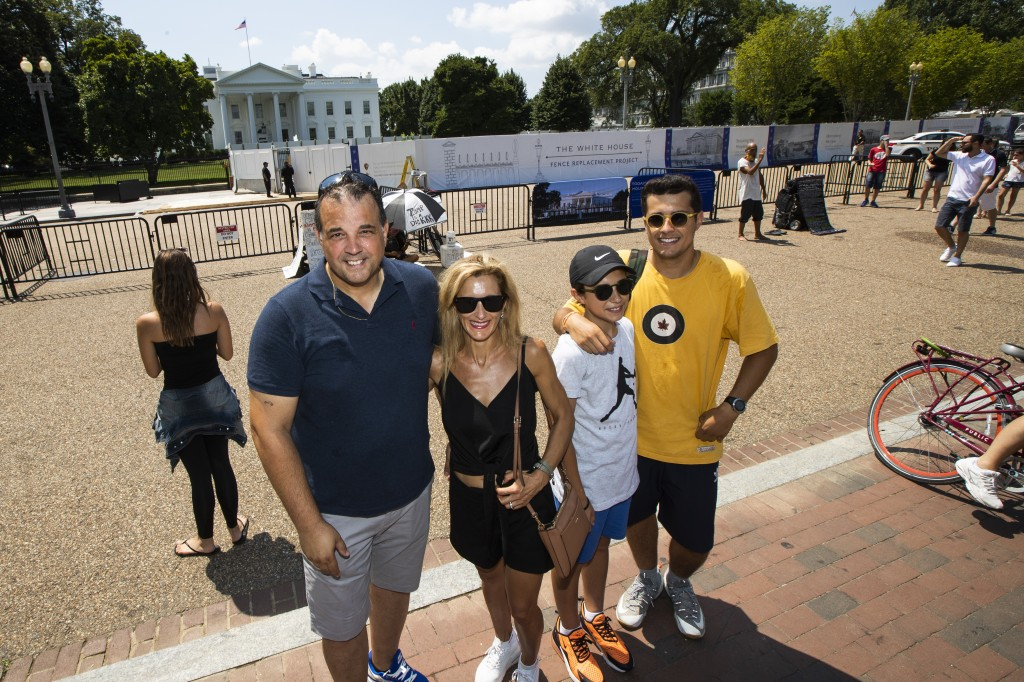 From left, Parisian Paul and Anne-paula Baptista, together with their sons Louis and Clement Baptista, pose in front of the White House in Washington,