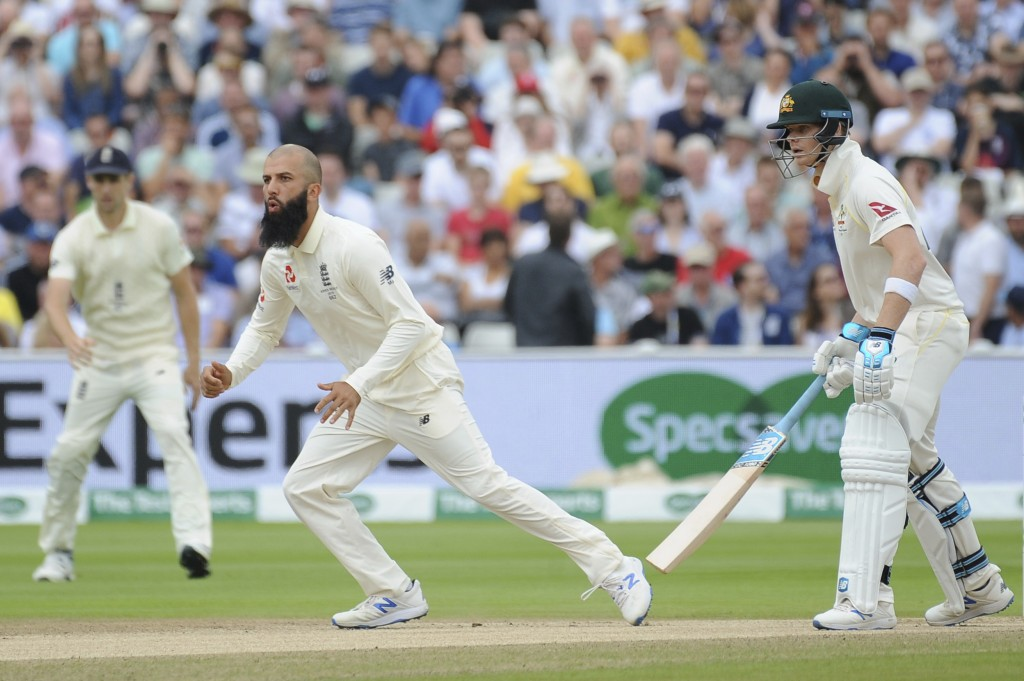 England's Moeen Ali looks on after bowling, during day four of the first Ashes Test cricket match between England and Australia at Edgbaston in Birmin...
