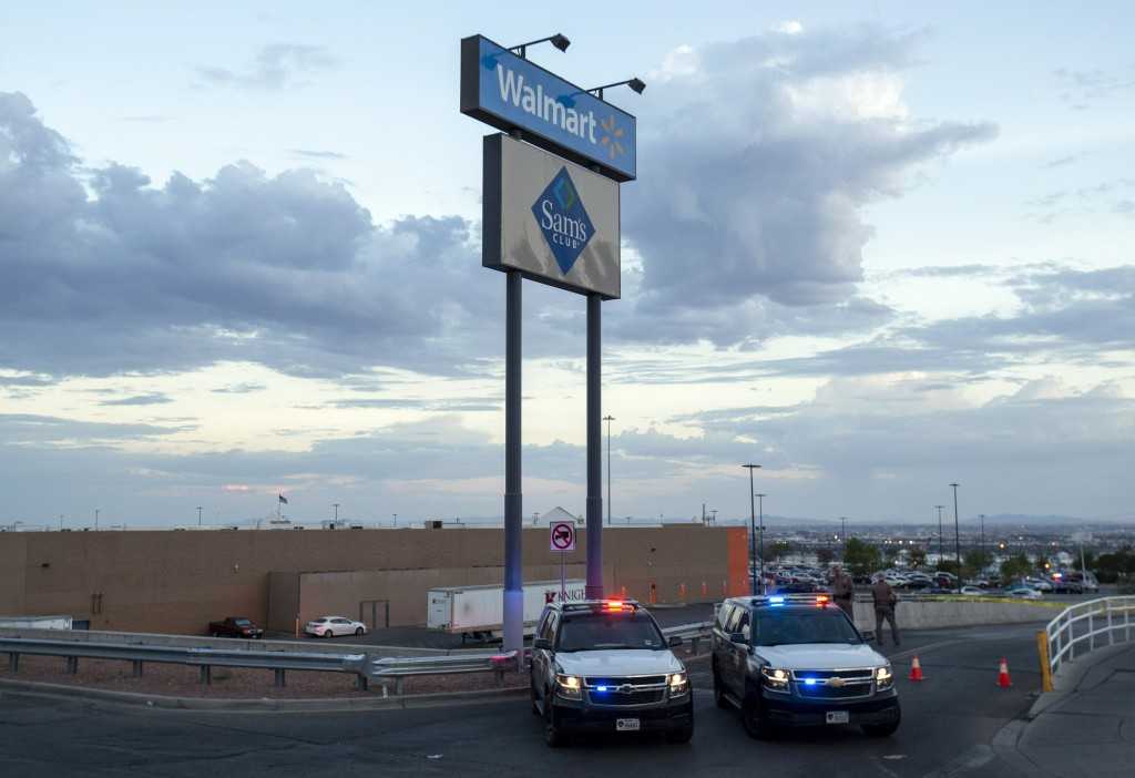 Texas state police cars block the access to the Walmart store in the aftermath of a mass shooting in El Paso, Texas, Saturday, Aug. 3, 2019. Multiple ...