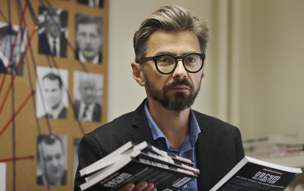 In this photo taken on Friday June 28, 2019, Grzegorz Rzeczkowski, an investigative reporter for the weekly Polish newsmagazine Polityka, poses with a