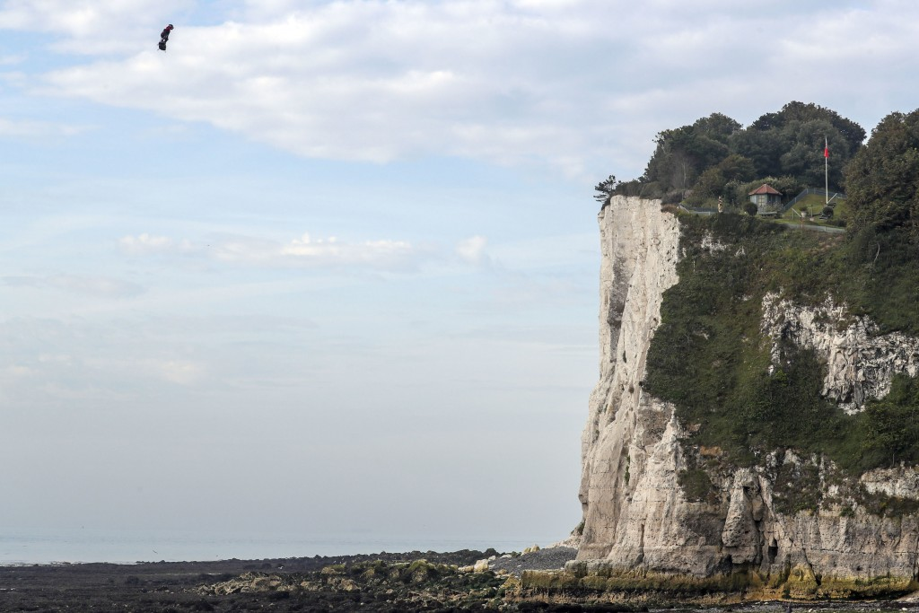 French inventor Franky Zapata lands near St. Margaret's beach, Dover after crossing the Channel on a flying board Sunday, Aug. 4, 2019. (Steve Parsons