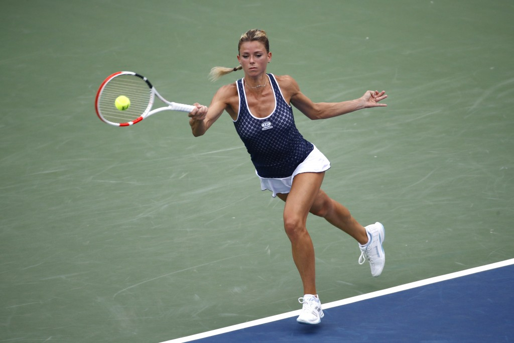 Camila Giorgi, of Italy, returns the ball during a semifinal match against Caty McNally at the Citi Open tennis tournament, Saturday, Aug. 3, 2019, in