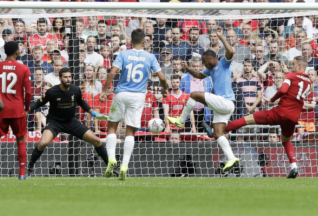 Manchester City's Raheem Sterling, second from right, scores his side's opening goal during the English Community Shield soccer match between Liverpoo