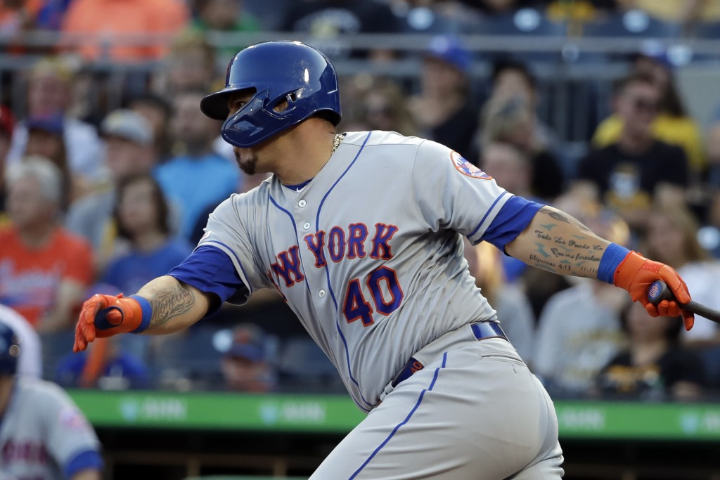 New York Mets' Wilson Ramos drives in a run with an RBI single off Pittsburgh Pirates starting pitcher Chris Archer during the first inning of a baseb