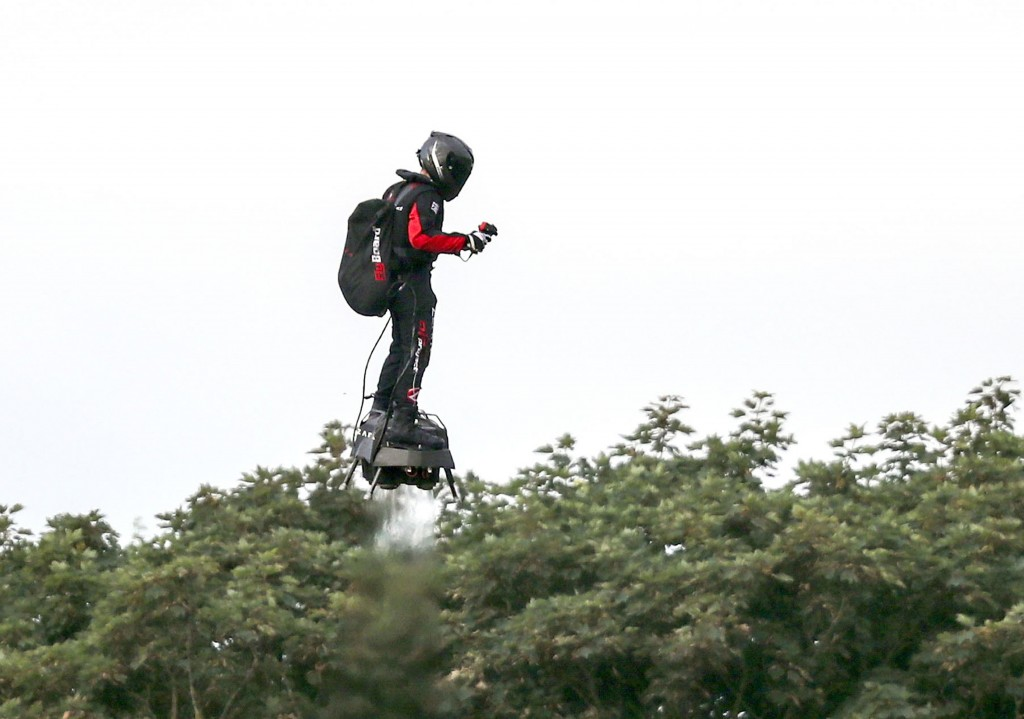 French inventor Franky Zapata flies near St. Margaret's beach, Dover after crossing the Channel on a flying board Sunday, Aug. 4, 2019. (Steve Parsons