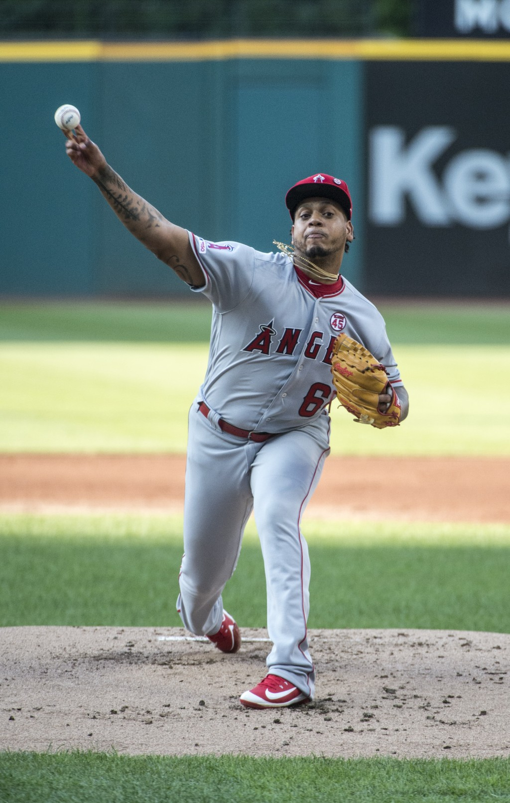 Los Angeles Angels starting pitcher Felix Pena delivers to Cleveland Indians' Francisco Lindor during the first inning of a baseball game in Cleveland...