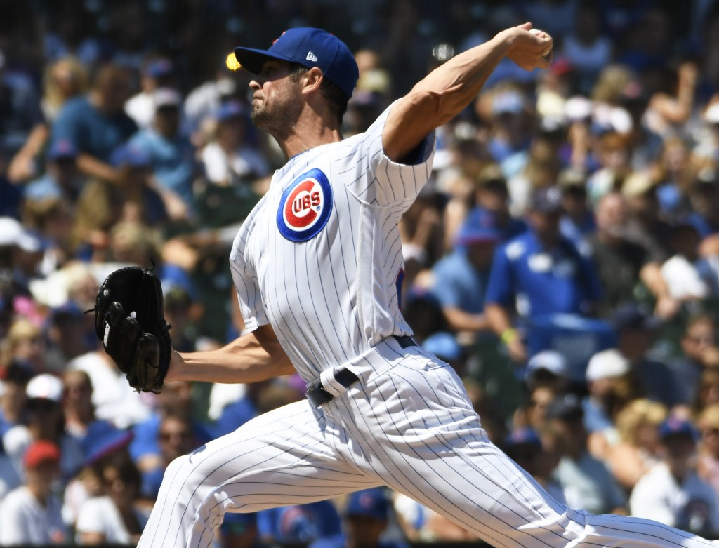 Chicago Cubs starting pitcher Cole Hamels (35) throws the ball against the Milwaukee Brewers during the first inning of a baseball game, Saturday, Aug...
