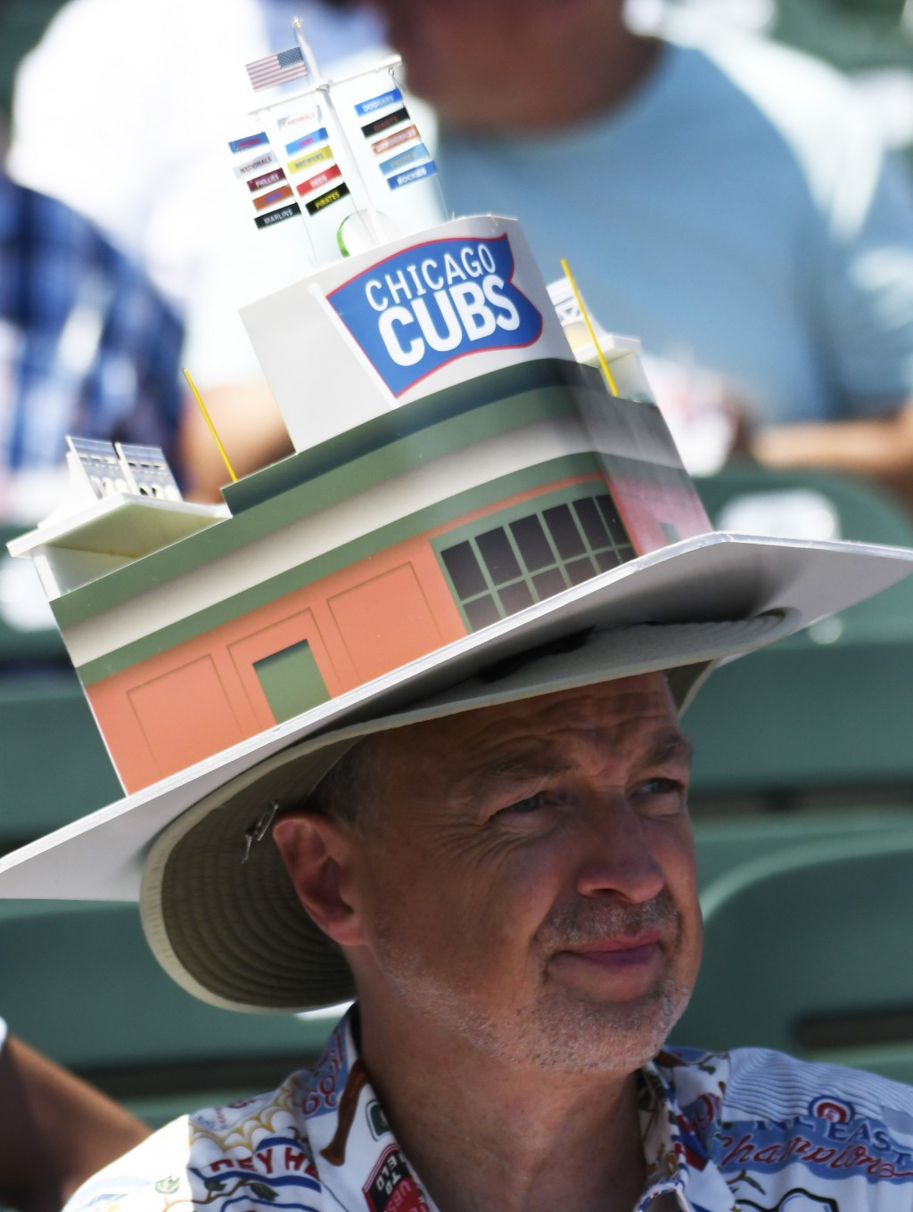 Kent Weakly sits in the stands before a baseball game between the Chicago Cubs and the Milwaukee Brewers, Saturday, Aug. 3, 2019, in Chicago. (AP Phot...
