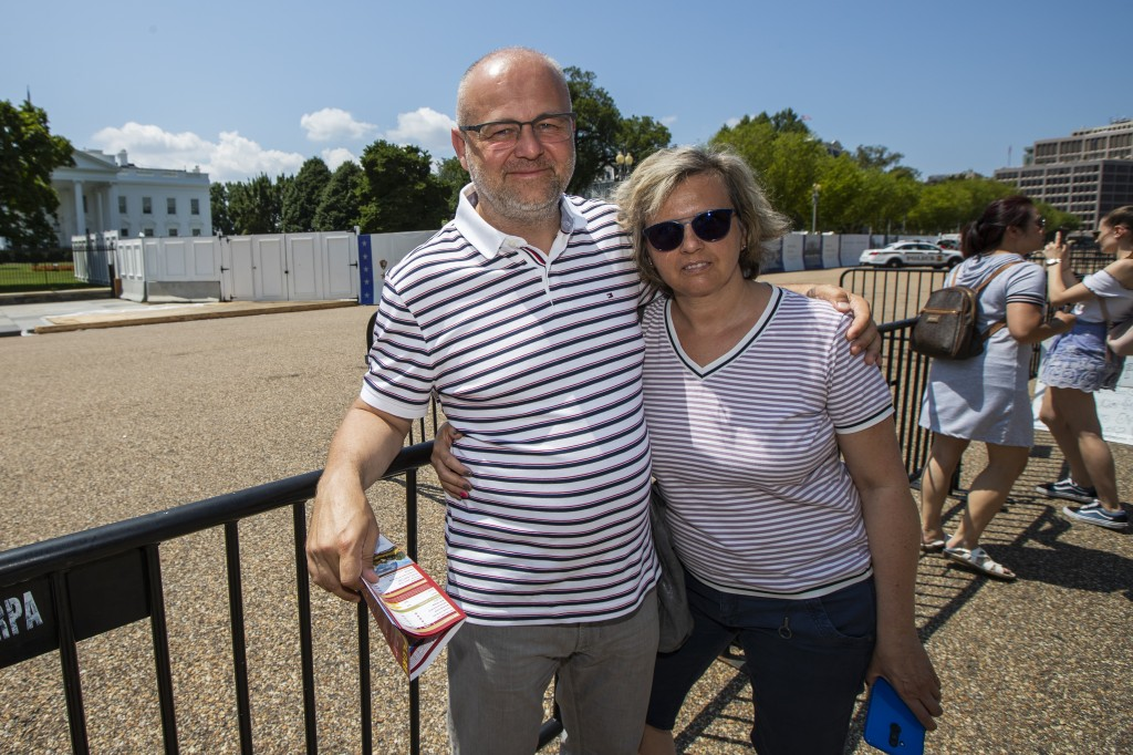 """Radek Klinowski, of Poland, and his wife, Naanna, pose for a picture in front of the White House in Washington, Thursday, Aug. 1, 2019. """"I would like ..."""
