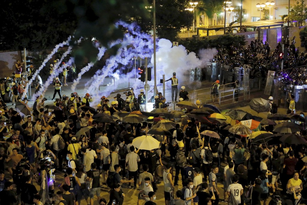 Police fire tear gas into a crowd in Wong Tai Sin district in Hong Kong on Saturday, Aug. 3, 2019. Protesters and authorities clashed in Hong Kong aga...