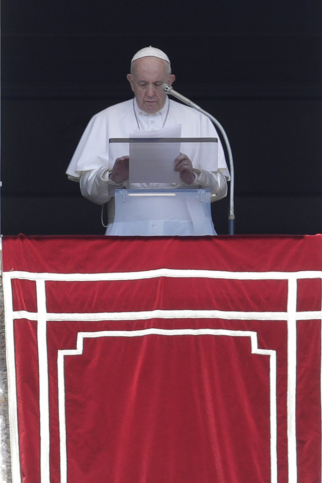 Pope Francis prays for the dead and injured of the three U.S. mass shootings, during the Angelus noon prayer in St. Peter's Square at the Vatican, Sun...