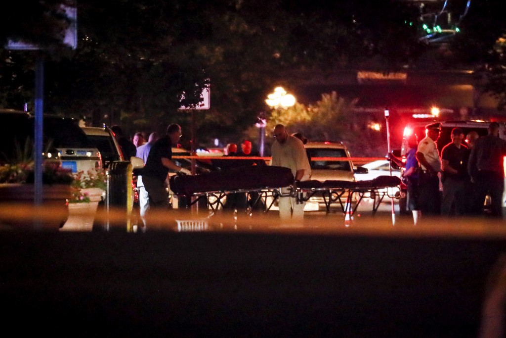 Bodies are removed from at the scene of a mass shooting, Sunday, Aug. 4, 2019, in Dayton, Ohio. Several people in Ohio have been killed in the second