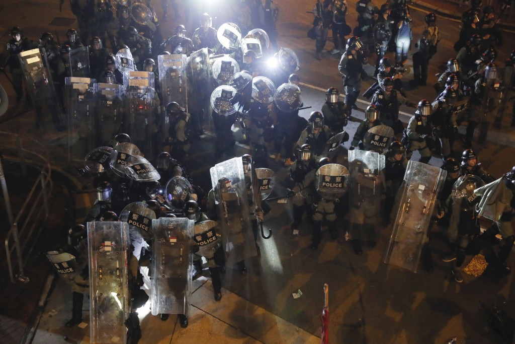 Riot police move into position in Wong Tai Sin district in Hong Kong on Saturday, Aug. 3, 2019. Protesters and authorities clashed in Hong Kong again ...