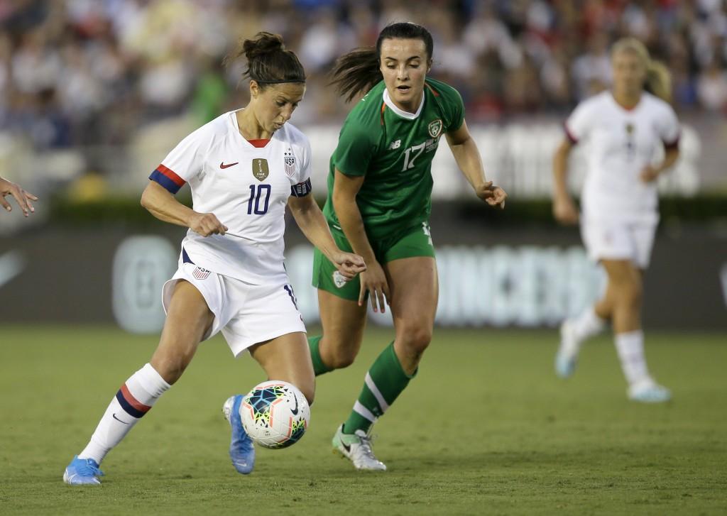U.S. forward Carli Lloyd, left, controls the ball with Ireland midfielder Niamh Farrelly defending during the first half of an international friendly ...