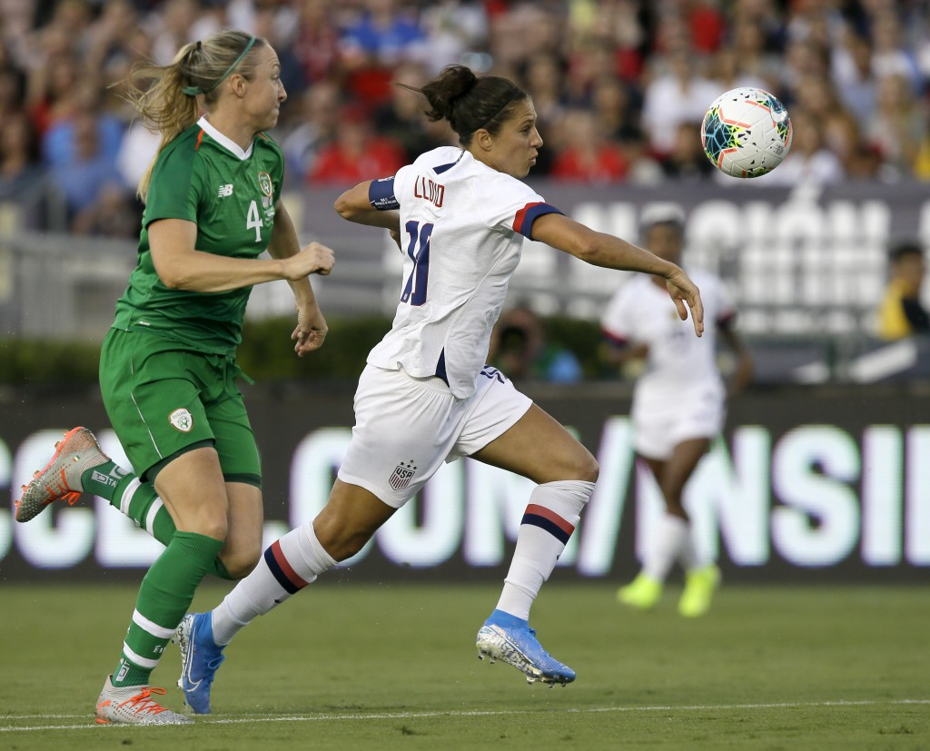 U.S. forward Carli Lloyd, right, battles for the ball with Ireland defender Louise Quinn during the first half of an international friendly soccer mat...